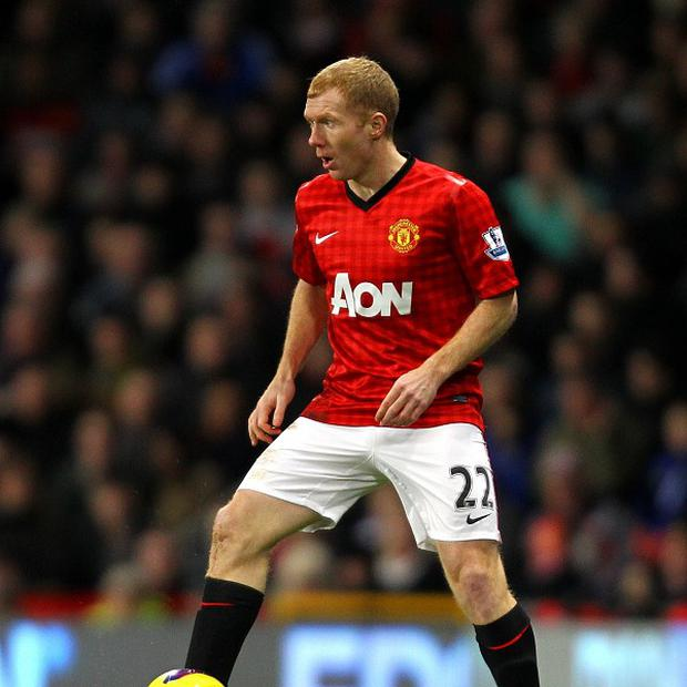 Paul Scholes is hanging up his boots