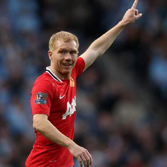 Paul Scholes is happy with the timing of his Old Trafford exit