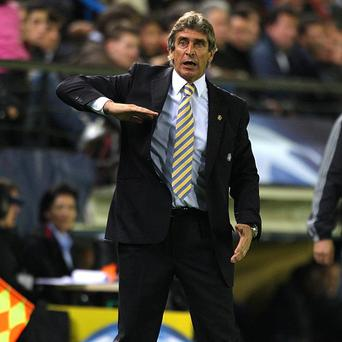 Manuel Pellegrini says he is focused on helping Malaga qualify for next season's Europa League