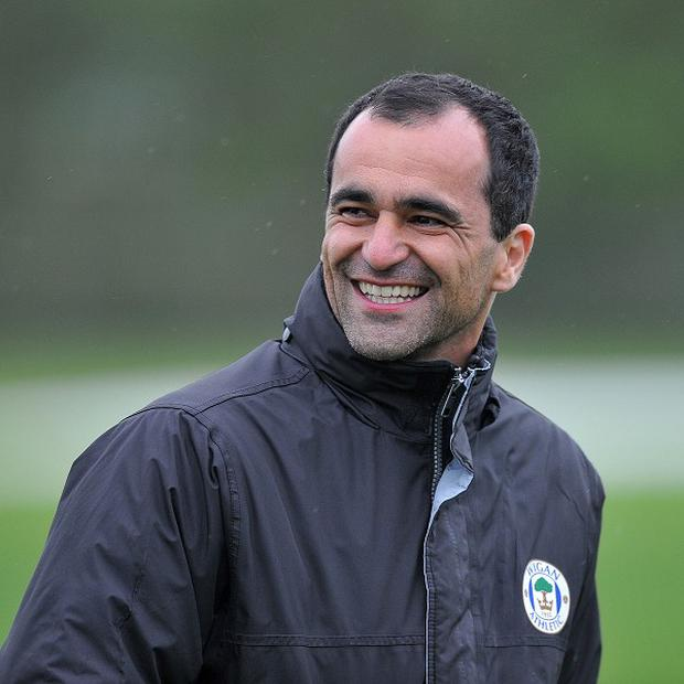 Roberto Martinez, pictured, has been tipped to succeed David Moyes as Everton manager