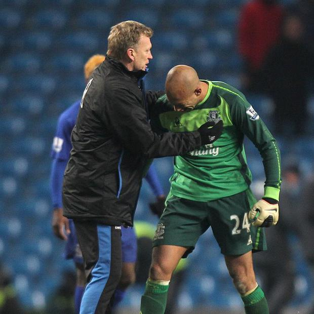 Tim Howard, right, believes David Moyes, left, has left a solid platform at Everton