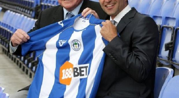 Roberto Martinez, right, is expected to have talks with Dave Whelan, left, once the season is over