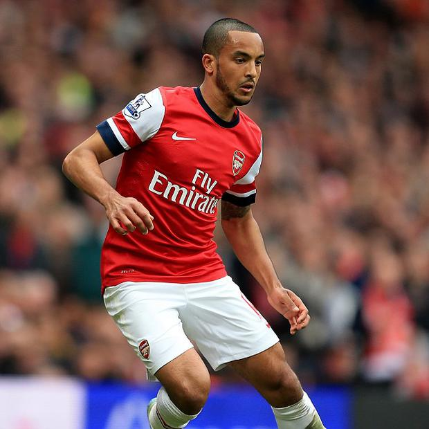 Theo Walcott was on target as Arsenal consigned Wigan to relegation