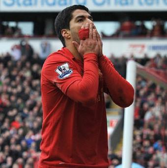 Jose Enrique believes Luis Suarez, pictured, is key to Liverpool's chances of kicking on next season