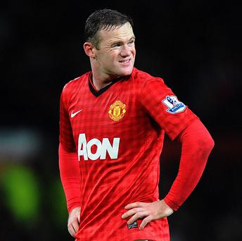 David Gill believes Wayne Rooney, pictured, will still be at Manchester United next season