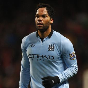 Joleon Lescott, pictured, says the Manchester City players have to accept Roberto Mancini's sacking