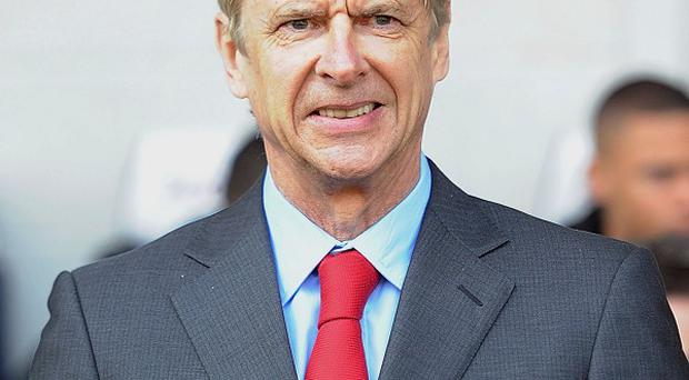 Arsene Wenger, pictured, says all the top clubs would be interested if Wayne Rooney became available