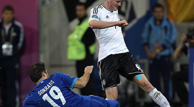 Andre Schurrle, right, is seemingly wanted by Chelsea and Borussia Dortmund