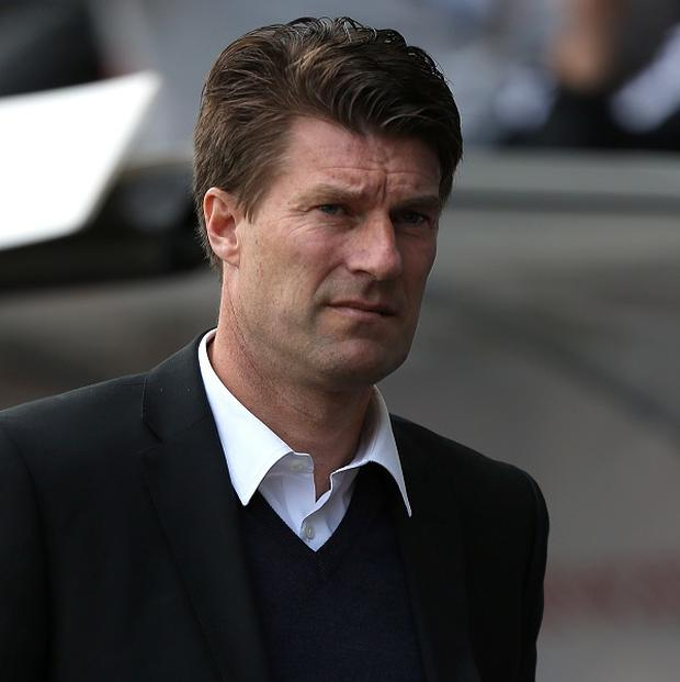 Michael Laudrup's agent, Bayram Tutumlu, is reported to have tried to broker a deal to sell Ashley Williams