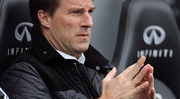 Michael Laudrup, pictured, has worked with Bayram Tutumlu since his days playing for Barcelona