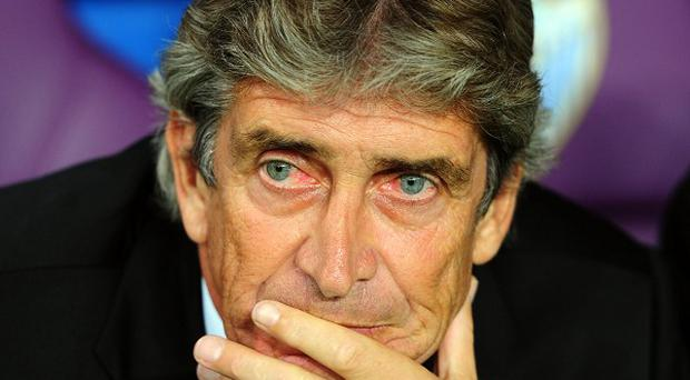 Former Malaga boss Manuel Pellegrini, pictured, has replaced Roberto Mancini as Manchester City manager