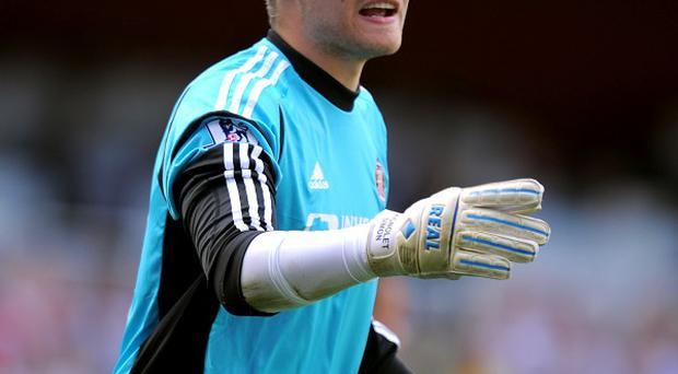 Simon Mignolet, pictured, could challenge Jose Reina for Liverpool's number one jersey