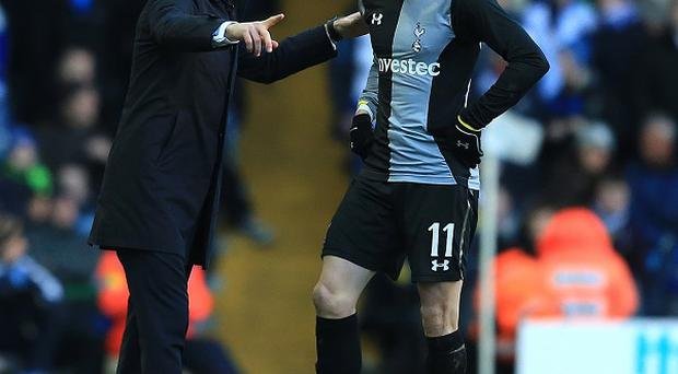 Andre Villas-Boas, left, has reiterated Tottenham's stance that Gareth Bale, right, is going nowhere