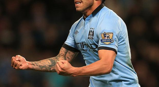 Carlos Tevez has swapped England for Italy