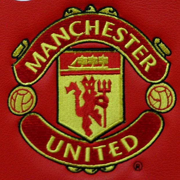 The Manchester United badge on a seat at Old Trafford