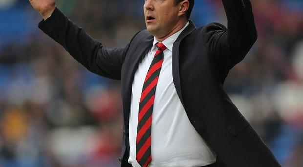 Malky Mackay, pictured, has added to his Cardiff squad by signing Andreas Cornelius