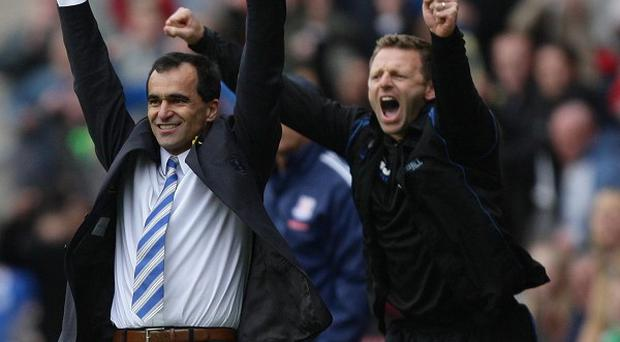 Roberto Martinez, left, and Graeme Jones will set about tweaking the way Everton play over the coming weeks