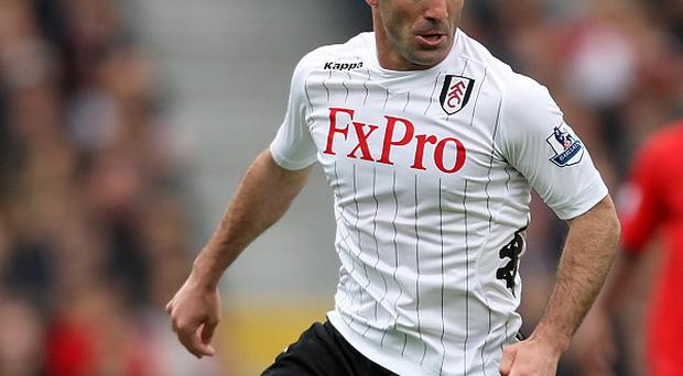 Giorgos Karagounis will stay at Fulham for another 12 months