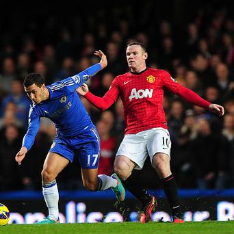 Eden Hazard (left) has said he would love to see Wayne Rooney (right) to join him at Chelsea