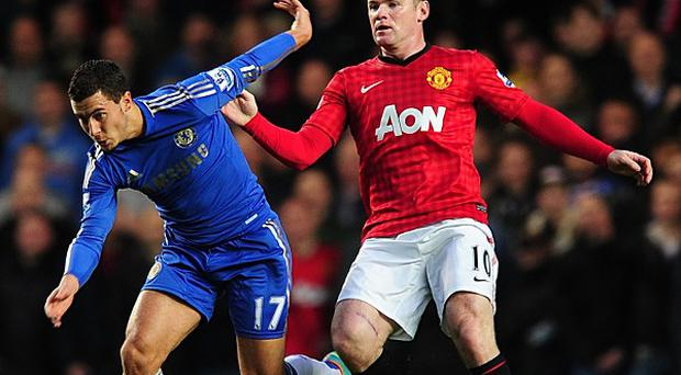 Eden Hazard, left, wants Wayne Rooney, right, to join him at Chelsea