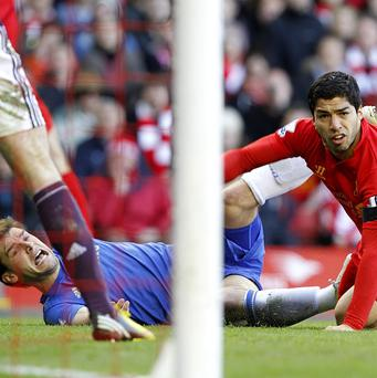 Branislav Ivanovic, left, and Luis Suarez, right, clashed at Anfield last season