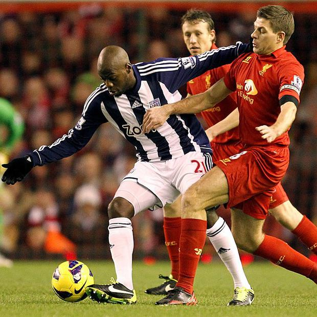 Youssouf Mulumbu, left, has signed a new deal with West Brom