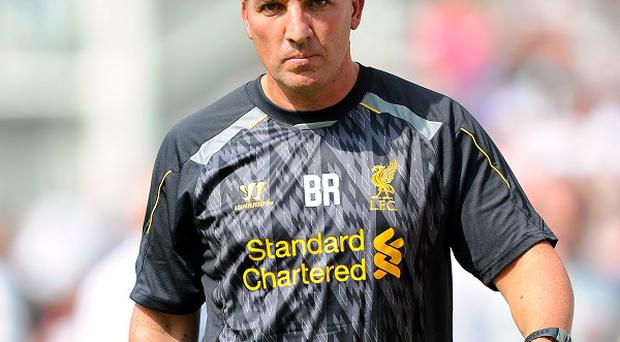 Brendan Rodgers, pictured, insists that Luis Suarez is not for sale