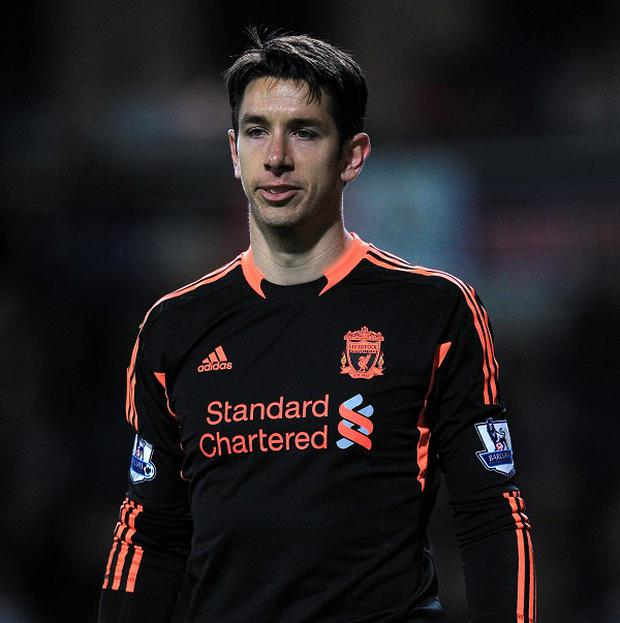 Brad Jones, pictured, insists Luis Suarez is still committed to Liverpool