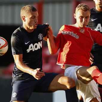 Nemanja Vidic, left, came through 62 minutes untroubled at Gresty Road