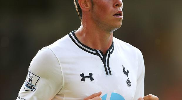Arsene Wenger would prefer to see Gareth Bale stay in the Premier League