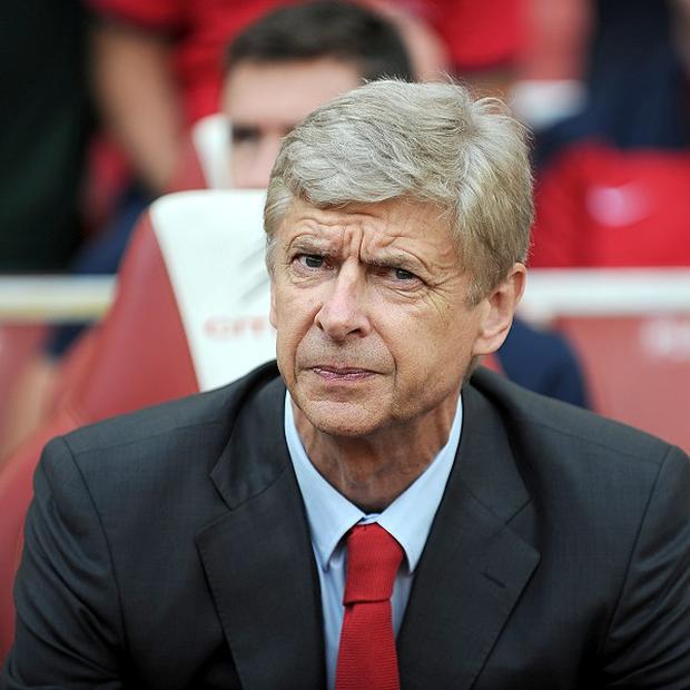 Arsene Wenger admitted that Arsenal had made a bid for Liverpool striker Luis Suarez