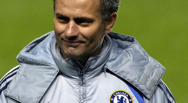 Jose Mourinho, pictured, told Michael Essien he was returning to Chelsea during his final match for Real Madrid