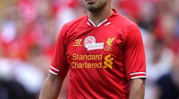 Jamie Carragher believes Luis Suarez, pictured, will remain at Anfield
