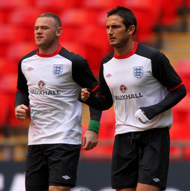 Frank Lampard, right, would like to see Wayne Rooney at Stamford Bridge