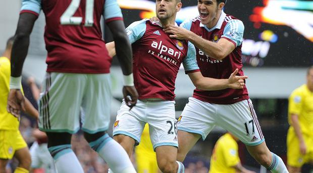Joe Cole, centre, opened West Ham's goalscoring account for the season