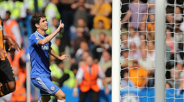 Oscar celebrates after opening the scoring for Chelsea