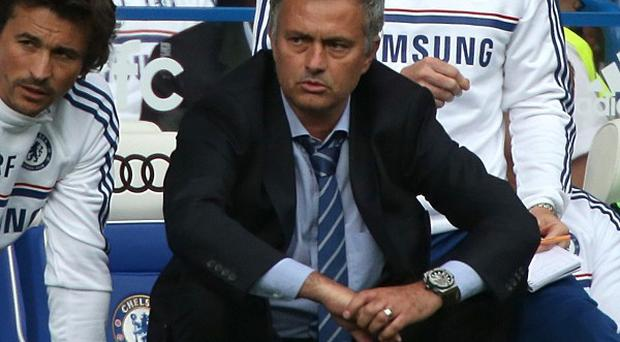 Jose Mourinho, pictured, has not given up hope of signing Wayne Rooney