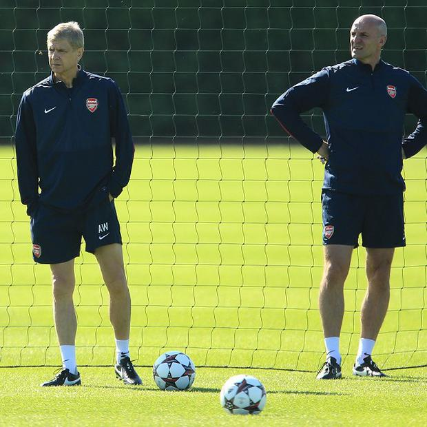 Arsene Wenger, left, and his assistant Steve Bould watch the Arsenal squad train on Tuesday
