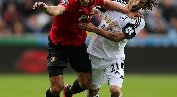 Robin van Persie, left, scored a brace in Manchester United's win over Swansea last Saturday