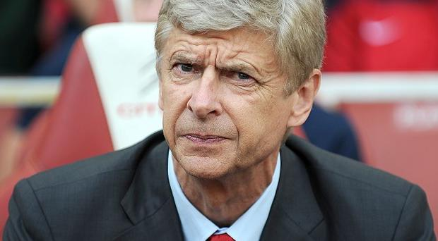Arsene Wenger expects to add to his Arsenal squad before the transfer window closes