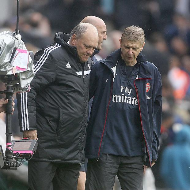 Arsene Wenger's, right, Arsenal secured a first Premier League win of the season at Craven Cottage