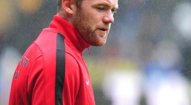 Wayne Rooney is believed to be unwilling to hand in a transfer request