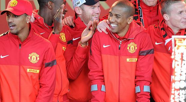 Ashley Young, third right, won his first Premier League medal last season