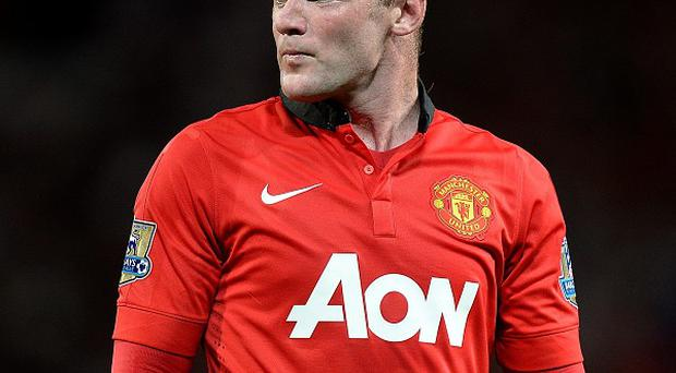Wayne Rooney looks set to miss Manchester United's encounter against Liverpool