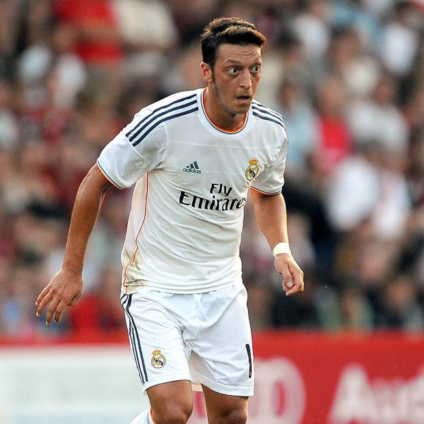 Real Madrid midfielder Mesut Ozil is reportedly a transfer target for Arsenal