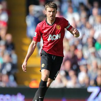 Michael Carrick, pictured, is pleased that Manchester United have added to their midfield ranks