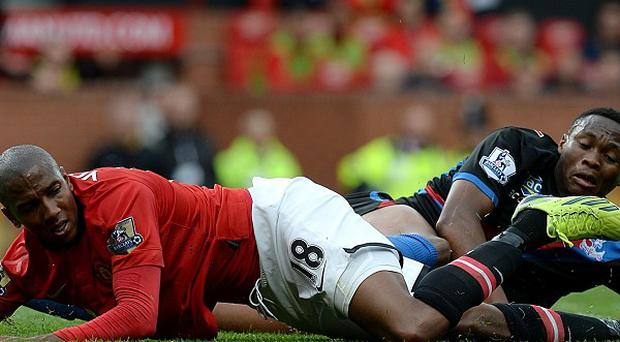David Moyes is planning to speak to Ashley Young, left, about the diving incident