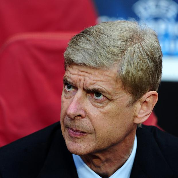 Arsene Wenger is worried fans will struggle with the heat in Qatar