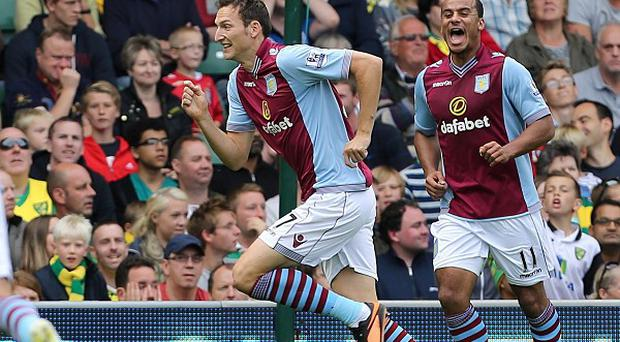 Libor Kozak, centre, celebrates after scoring the only goal