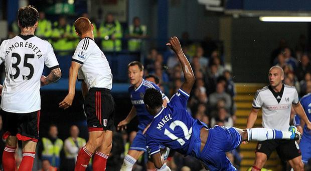 John Obi Mikel, right, stabs in his first ever league goal for Chelsea